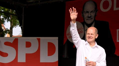 SDP leader Olaf Scholz waves to supporters during a campaign event at Schillerplatz in Nürtingen, Germany, Sept. 20, 2021. (Bernd Weißbrod/picture alliance via Getty Images)
