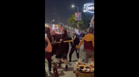 Pro-Palestinian demonstrators are captured on cellphone video physically attacking Jews at a restaurant in Los Angeles, May 18, 2021. (Screenshot)