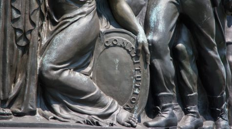 The Confederate Memorial at Arlington National Cemetery includes the image of a woman protecting a shield emblazoned with the word Constitution. (Tim Evanson/Flickr Commons)