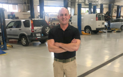 Mark Schenberg in his automotive repair shop, Car-Doc, located in Maryland Heights. Note the tidiness and immaculate floors.