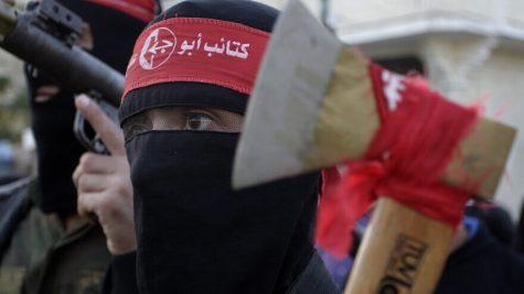Palestinian militants from the Popular Front for the Liberation of Palestine (PFLP) take part in a military show to celebrate the 47th anniversary of the groups founding, in Khan Younis in the southern Gaza Strip, on December 11, 2014. Photo by Abed Rahim Khatib/Flash90 *** Local Caption *** ôìñèéðéí òæä äçæéú äòîîéú ôìñèéï öòãä òöøú