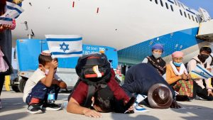 New Bnei Menashe immigrants kissing the ground after arriving in Israel on October 13, 2021. Photo by Laura Ben David/Shavei Israel