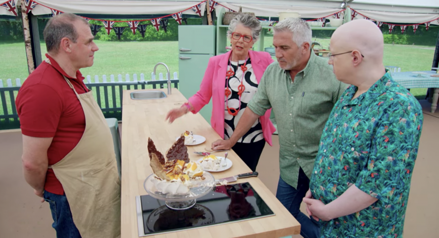 Jurgen Krauss, who bakes challah for his familys synagogue, shows off his Passover-inspired pavlova in The Great British Baking Show tent. (Screenshot from Netflix)