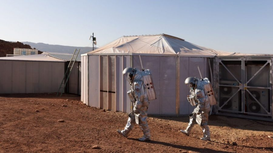 The+astronauts+walk+past+their+intended+habitat.+Photo+by+Florian+Voggeneder%2FOeWF