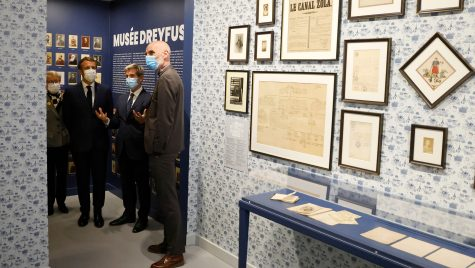 French President Emmanuel Macron, third from right, visits the Dreyfus Museum in Médan near Paris, on Oct. 26, 2021. (Ludovic Marin/AFP via Getty Images)