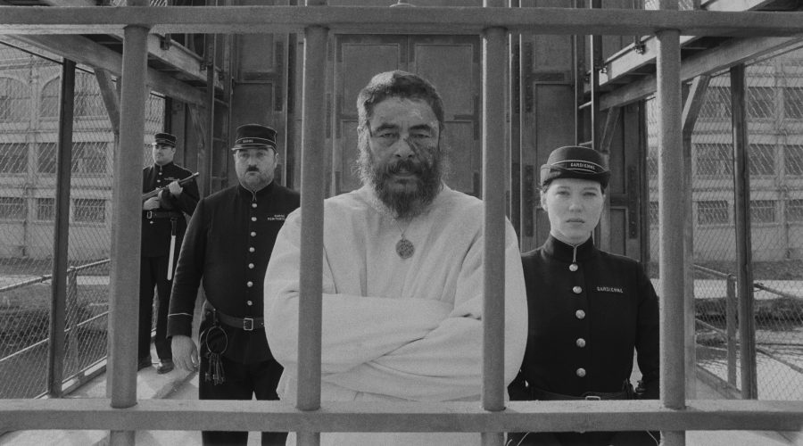 Benicio del Toro, center, as painter Moses Rosenthaler, and Léa Seydoux, right, as the prison guard Simone in The French Dispatch. (Searchlight Pictures)