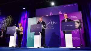 From left: Holocaust survivor Dina Rajs, World Jewish Congress President Ronald Lauder and Swedish Prime Minister Stefan Lofven onstage at the Malmö International Forum on Holocaust Remembrance and Combating Antisemitism in Malmö, Sweden, Oct. 13, 2021. (Jonas Ekstromer/TT News Agency/AFP via Getty Images)